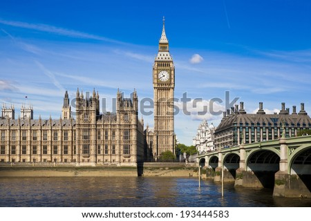 LONDON, UK - MAY 14, 2014  - Big Ben and houses of Parliament on the river Thames, London UK - stock photo