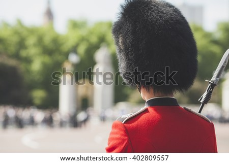 LONDON - UK, MAY 27: British Royal guard on Buckingham Palace before Queen Elizabeth II and Prince Philip in the Royal Coach will eave go to the State Opening of Parliament  in London, England - stock photo
