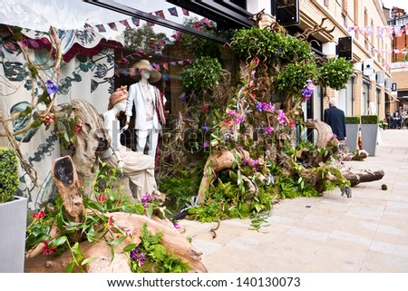 LONDON, UK-MAY 26: Designer Massimo Dutti's Store is decked out with exotic plants and woods as part of the Chelsea Fringe celebrating 100 years of the Chelsea Flower Show. May 26, 2013 London UK. - stock photo