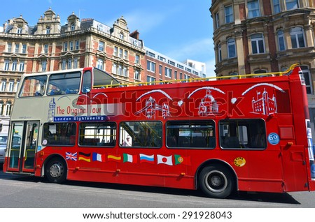 LONDON, UK - MAY 14 2015:London Tour buse.It's a bus service that takes visitors sightseeing, with routes around tourist attractions in London England, UK. - stock photo
