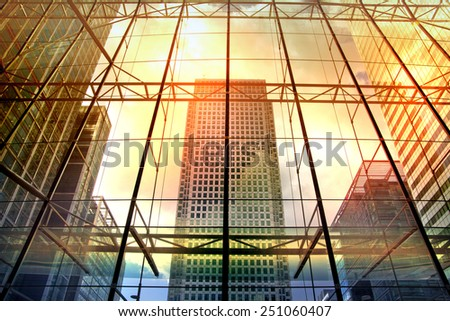 LONDON, UK - MAY 14, 2014: Office buildings of Canary Wharf. Modern architecture the leading centre of global finance in sun set lights - stock photo
