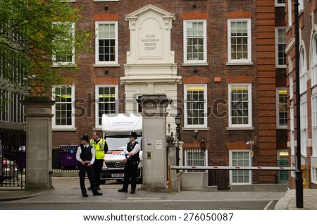LONDON, UK - MAY 7, 2015:  Police and security staff outside the headquarters of the Conservative Party in Westminster on the day of the General Election in the UK. - stock photo