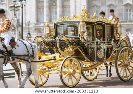 LONDON - UK, MAY 27: Queen Elizabeth II and Prince Philip in the Royal Coach leave Buckingham Palace and go to the State Opening of Parliament on May 27, 2015 in London, England - stock photo