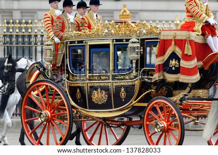 LONDON - UK, MAY 08: Queen Elizabeth II and Prince Philip leaving Buckingham Palace and going to the State Opening of Parliament on May 8, 2013 in London. - stock photo