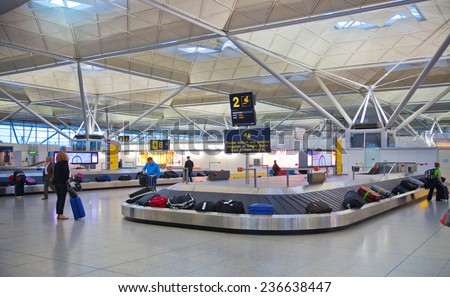 LONDON, UK - MAY 28, 2014: Stansted airport, luggage waiting area - stock photo