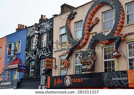 London, UK - May 27: street art in Camden High Street in London, UK, on May 27, 2015. The street is known for its vintage and alternative shops attracting locals and tourists. - stock photo