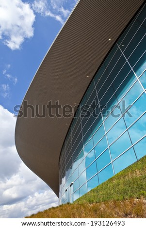 LONDON, UK - MAY 15TH 2014: The impressive Aquatics Centre located in the Queen Elizabeth Olympic Park in Stratford, London on 15th May 2014. - stock photo