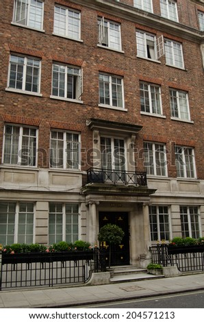 LONDON, UK - MAY 15, 2014:  The American journalist Edward R Murrow lived in flat 5 of this block during World War II and broadcast dispatches from BBC Broadcasting House just down the road. - stock photo