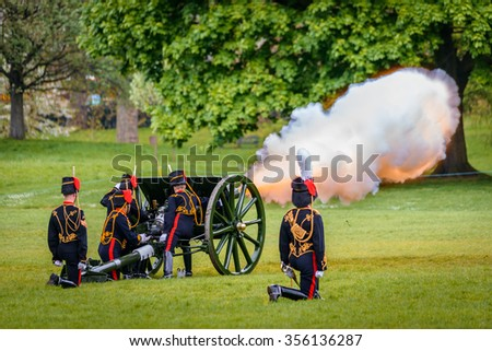 LONDON - UK, MAY 08, 2013: The King's Troop in Green Park are firing gun salutes for State Opening of Parliament. - stock photo