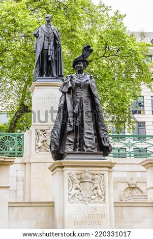 LONDON, UK - MAY 30, 2013: View of Bronze Statue of Queen Elizabeth (wife of King George VI) and Statue of King George VI on the Mall. King George VI Memorial. - stock photo
