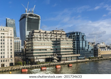 LONDON, UK - MAY 25, 2013: View of River Thames and 20 Fenchurch Street - commercial skyscraper under construction. Skyscraper has been nicknamed The Walkie-Talkie because of its distinctive shape. - stock photo