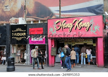 LONDON, UK - MAY 15, 2012: Visitors walk along shops in Camden Town, London. According to TripAdvisor, Camden Town currently is one of top 10 shopping destinations in London. - stock photo