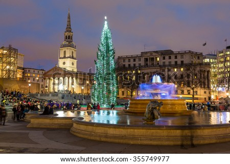 LONDON, UK - 22ND DECEMBER 2015: A view of Trafalgar Square in London during the Christmas Period. The Christmas Tree, fountains, buildings and people can be seen. - stock photo