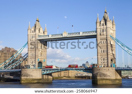 LONDON, UK - 2ND MARCH 2015: A beautiful view of Tower Bridge under a clear sky in London on 2nd March 2015.  Docklands can also be seen in the distance. - stock photo