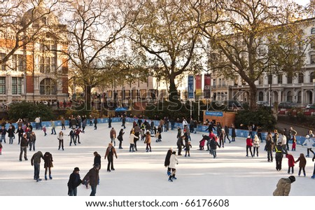LONDON,UK-NOVEMBER 28: Skaters Beating the Winter Blues at the Annual Christmas Ice Rink at the Famous Natural History Museum on November 28, 2010 in London. - stock photo