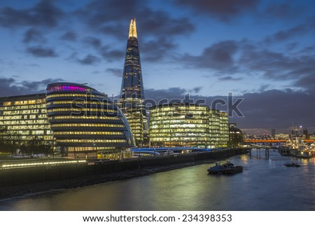 LONDON, UK - November 8th 2014 - A long exposure shot of The Shard and City Hall at Night - stock photo