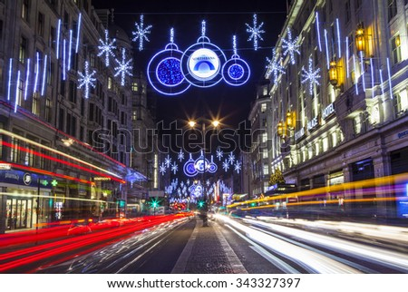 LONDON, UK - NOVEMBER 24TH 2015: The beautiful Christmas lights illuminating the Strand in central London, on 24th November 2015. - stock photo