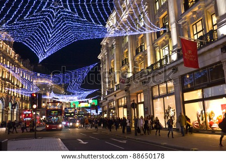 LONDON, UK-NOVEMBER 10: The annual colourful Christmas lights are strung across London's famous Regents Street, to welcome and encourage shoppers to the street. November 10, 2011 in London UK. - stock photo