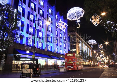 London, UK - November 10, 2011: The Christmas lights decorations outside House Of Fraser at night, in Oxford Street during the festive season - stock photo