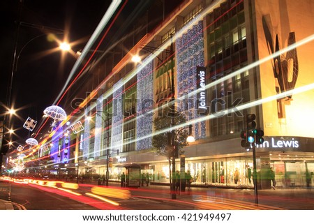 London, UK - November 10, 2011: The Christmas lights decorations outside John Lewis department store at night, in Oxford Street during the festive season - stock photo
