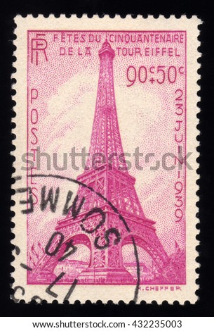 London, UK, November 10 2010 - Vintage 1939 France cancelled postage stamp showing an engraved image of the Eiffel Tower in Paris - stock photo