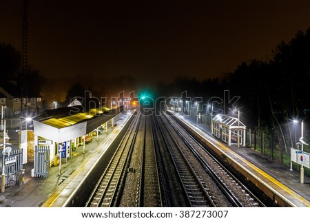 London, UK. 30 October 2014.  A night view of Penge West Station in South London.  Increasing rail fares for London commuters are a current hot topic.  - stock photo