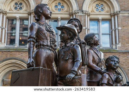 LONDON, UK - OCTOBER 11, 2014 : Bronze Kindertransport statue of 5 children by sculptors Frank Meisler and Arie Oviada at Liverpool Street Railway Station in central London. - stock photo