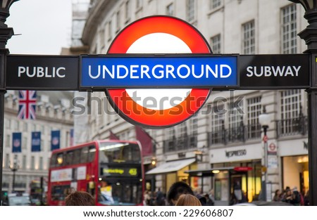LONDON, UK - OCTOBER 17, 2014: Piccadilly Circus street underground tube station on October 17, 2014 in London, England. London's underground railway is the oldest in the world, dating back to 1863.  - stock photo