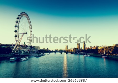 LONDON, UK - October 05, 2014: Retro Photo Filter Effect  - London Skyline landscape at Sunrise with Big Ben, Palace of Westminster, London Eye, Westminster Bridge, River Thames, London, England, UK. - stock photo