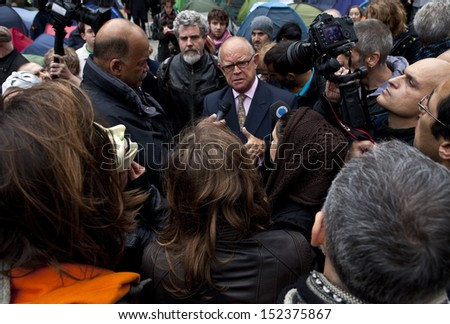 LONDON, UK - OCTOBER 30TH 2011: Ex Banker David Buik being interviewed by the Press at the Occupy London protest camp outside St. Paul's Cathedral in London on 30th October 2011. - stock photo