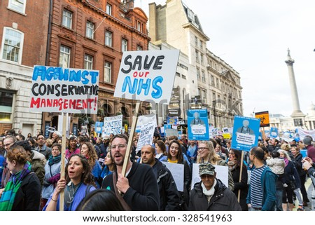 LONDON, UK - OCTOBER 17, 2015: Thousands Junior doctors marching in London streets to campaign against NHS contract changes - stock photo