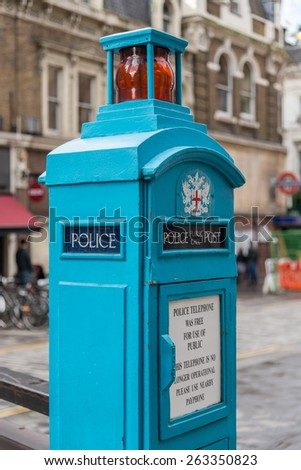 LONDON, UK - OCTOBER 11, 2014 : Vintage blue police phone post in central London outside of Liverpool Street Railway Station. These boxes were introduced in 1891 for police and public use. - stock photo