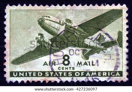London, UK, October 20 2007 - Vintage 1941 United States of America cancelled postage stamp showing an image of a mail plane - stock photo
