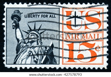 London, UK, October 27 2007 - Vintage 1959 United States of America cancelled postage stamp showing an image of the Statue of Liberty - stock photo