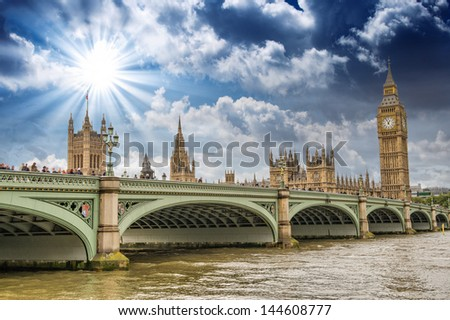 London, UK - Palace of Westminster (Houses of Parliament) with Big Ben clock tower and Westminster bridge over Thames river at sunset. - stock photo