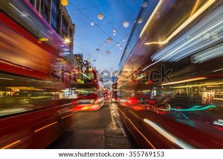 LONDON, UK - 23RD DECEMBER 2015: Busy Traffic down Oxford Circus in London during the Christmas Season. Double Decker Buses can be seen. - stock photo
