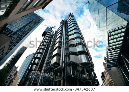 LONDON, UK - SEP 27: Financial district office buildings in street on September 27, 2013 in London, UK. London is the world's greatest foreign exchange market with major trade conducted in district. - stock photo