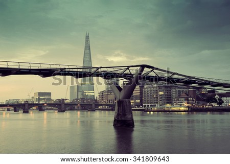 LONDON, UK - SEP 27: The Shard and Millennium Bridge on September 27, 2013 in London, UK. London is the world's most visited city and the capital of UK. - stock photo