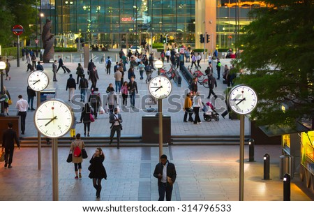 LONDON, UK - 7 SEPTEMBER, 2015: Canary Wharf business life. Business people going home after working day. - stock photo