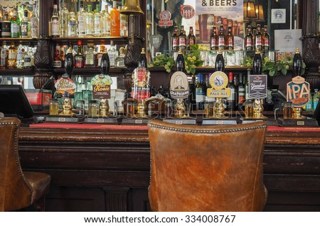 LONDON, UK - SEPTEMBER 28, 2015: Draught cask beers in a traditional English Pub - stock photo