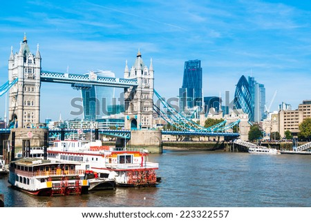 LONDON, UK - SEPTEMBER 28, 2014: Famous Tower Bridge and the financial district along the River Thames on September 28, 2014 in London, UK. - stock photo