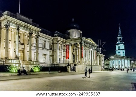 LONDON, UK - SEPTEMBER 1, 2013: Night shot of Trafalgar Square. National Gallery houses a rich collection of over 2,300 paintings dating from the 13th to 19th century. - stock photo