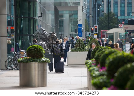 LONDON, UK - SEPTEMBER 14, 2015:  Office workers going at work. Early morning hours in Canary Wharf business life - stock photo