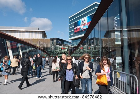 LONDON, UK- SEPTEMBER 13: Shoppers on the opening day of Westfield Stratford City, the largest urban shopping centre in Europe, and gateway to the Olympic Park. September 13, 2011 London UK - stock photo