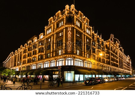 LONDON, UK - SEPTEMBER 25, 2014: The famous Harrods department store in the evening of September 25, 2014 at Knightsbridge in London, UK. Harrods is the biggest department store in Europe and offers - stock photo
