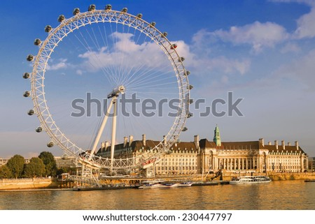 LONDON, UK - SEPTEMBER 19, 2014: View of the London Eye in afternoon on September 19, 2014. The London Eye is a famous tourist attraction on river Thames in the capital city London. - stock photo