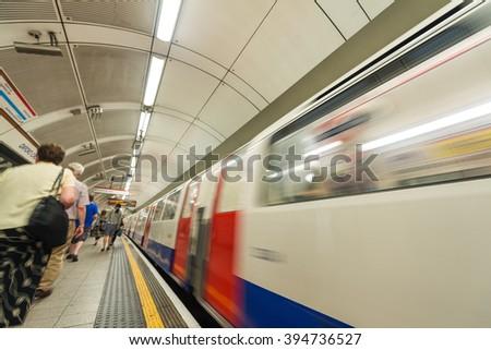 London, UK. Subway train leaving station. - stock photo