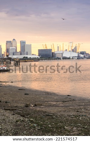 LONDON, UK - 26th JULY 2014: ,Thames river ,o2 arena and poor riverbank London on 26 July 2014 - stock photo