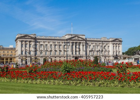 LONDON, UK - 18TH JULY 2015: The outside of Buckingham Palace in London during the summer showing the buildings and flowers. People can be seen outside. - stock photo
