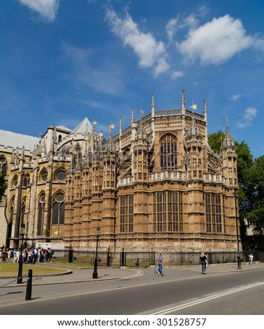 LONDON, UK - 18TH JULY 2015: The outside of part of Westminster Abbey during the day. People can be seen outside. - stock photo